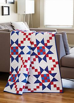 Free pattern: Make this bold patriotic quilt in red, white, and blue solids. Shining star blocks make this Quilt of Valor quilt project the star of the show.