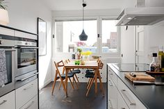 A bright, lovey breakfast area and an efficient looking kitchen.