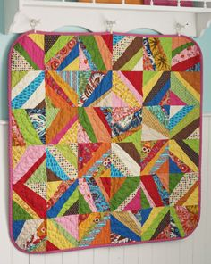 Modern Baby Quilt. Could sew together scraps and then cut into squares!