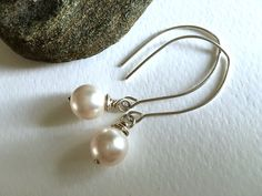 A flash of white for springtime shine! Bria classic gift. https://www.etsy.com/listing/263239771/minimalist-modern-wire-wrapped-pearl #etsymntt #bridesmaid #fashion