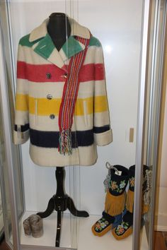 Hudson Bay coat and beaded boots on display at the Historic Saugeen Métis Interpretive Learning Centre in Southampton, Ontario.