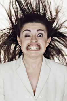 Pictures of peoples faces in gale-force winds