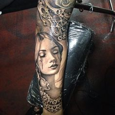 Beautiful tattoo. Woman's face and other detail.