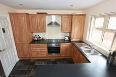 Pippy Oak Kitchen in Portland Hall by Kitchens Direct NI