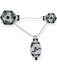 A FINE ART DECO DIAMOND AND GEM-SET PENDANT WATCH, BY VERGER FRÈRES. The two hexagonal diamond, cabochon sapphire, jade and onyx clusters suspending a pearl chain and similarly designed tonneau-shaped watch, the reverse with cream dial and Arabic numerals within a platinum and black enamel surround, circa 1925, with French assay mark for platinum. #VergerFreres #ArtDeco #watch