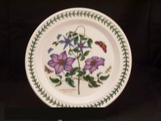 """Portmeirion Botanic Garden Dinner Plate(s) - Virgins Bower by Portmeirion. $25.99. Dimensions: 10 1/2"""" Dia. Brand New - First Quality. Dinner Plate(s) - Virgins Bower - Various Flowers Portrayed With The Name And Species Given For Each - Butterfly/Dragonfly Accents - White Background - Laurel Leaf Band On Rim - Design By Susan Williams-Ellis - Made In China"""