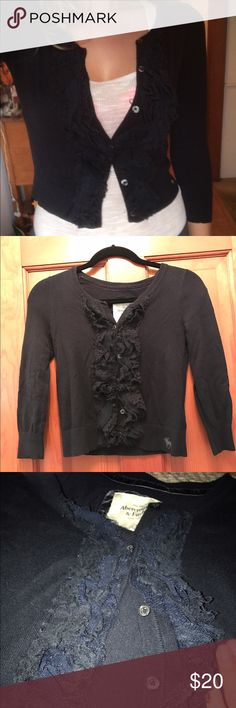 Abercrombie Cardigan This cardigan is in perfect shape! It is a quarter sleeve and it is a crop top length. It is navy blue and buttons all the way up. Always kept in a smoke-free home! Abercrombie & Fitch Sweaters Cardigans