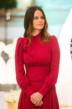 Princess Sofia opted for a stylish deep Gucci red dress with pleated skirt detail and a pussybow collar