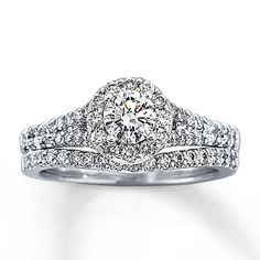 Beautiful A dazzling round diamond is the captivating centerpiece of this elegant engagement ring for her
