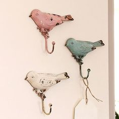 These rustic looking pastel colored bird wall hooks are so cute and would look great on any wall!