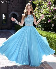 This dazzling princess gown is the only one in its class. Sheath-like top with cap sleeves and waist with hand beaded pattern compliments the floor length, full flowing skirt on this formal evening gown.