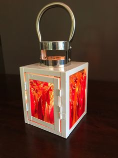 I took the panels out of this lantern and replaced with some fused glass panels I had done. Inside with candle. Quite happy with how it turned out.