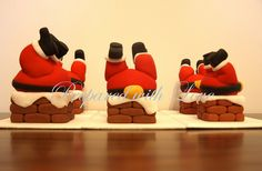 Fat Santa's stuck in a chimney christmas cake toppers, available from www.preparedwithlove.co.uk