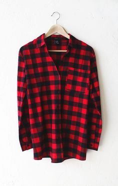 "- Description Details: Relaxed oversized button down plaid flannel shirt in red/black with a patch pocket. Oversized fit. Measurements (Size Guide): S: 40"" bust, 27.5"" length, 22.5"" sleeve length M: 4"