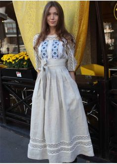 Designer linen dress with embroidery and openwork cross.