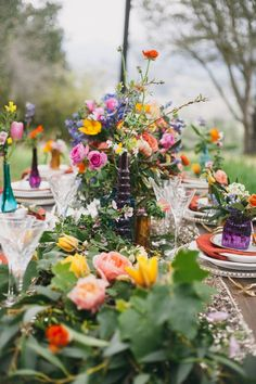 bohemian wedding tablescape - photo by Alexandra Wallace http://ruffledblog.com/bohemian-garden-wedding-with-color