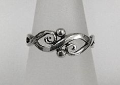 R.E. Piland Celtic Jewelry Designer. I have always loved Celtic designs. I would love to make a ring like this is looks quite simple.