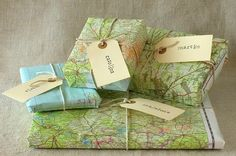 I try to recycle maps from work into notepads , scrap paper and gift wrap.  Shredding the maps for stuffing for your gift bags is a good way to re-use items as well.