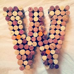 Wine Cork Letter Wreath for your Home or Wedding by TheBootletter, $45.00  DIY using corks from your wedding glued to a wooden letter!