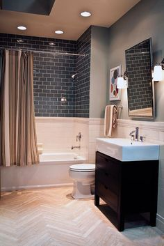 I like the double tile, and the regular walls with the stone floor.Herringbone stone floor with ceramic and glass subway tile walls. Hall Bathroom, Upstairs Bathrooms, Bathroom Renos, Bathroom Renovations, Bathroom Ideas, Bathroom Grey, Bathroom Layout, Bathtub Tile, Glass Tile Bathroom