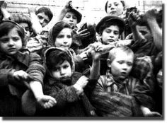 These children were liberated from Auschwitz. Asked what their names were they answered by lifting up their sleeves (as shown) to show the numbers that were tattooed on them.