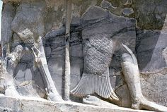 Relief showing the lower part of a man wrapped in a fish cloak on the right presumably representing Oannes. Palace S at Pasargadae, Iran, ca. 546–529 BC.