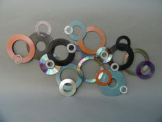 "www.greenlifegallery.com  ""Homage""  This piece was made from used and discarded CDs & DVDs.   The intent is to create original works of art while diverting waste from our landfills.  #CD #DVD #cases #plastic #art #eco-art #green #upcycled #recycled #media #disc #reuse #creative #décor"