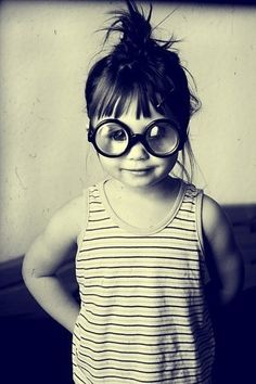 so cute...reminds me of me a bit at 6 with glasses.