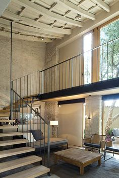 sweeping staircase, lots of light