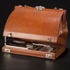 A novelty vanity case in the form of a Gladstone bag; fine tan leather with nickel fittings and cut glass bottles. One leather retaining strap broken; Old Luggage, Luggage Bags, Gladstone Bag, Cut Glass, Glass Bottles, Tan Leather, Vanity, Suitcases, Collection