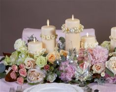 Oasis Raquette Centerpiece; Gorgeous - but so easy to do!  Simply soak and poke!  See all free flower tutorials.