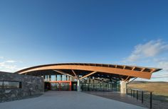 The sweeping arc of the Visitor Centre's roof and the adjacent viewing terrace.