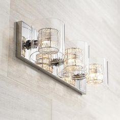 This striking wire wrapped, polished chrome 3-light bathroom light will illuminate a bathroom with contemporary style.