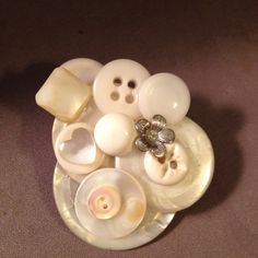A group of white buttons will make a nice brooch