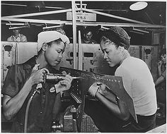 The six plane factories of the Douglas Aircraft Company has been termed an industrial melting pot, since men and women of 58 national origins work side by side in pushing America's plane output. S. O. Porter, Douglas's director of personnel, recently declared that Negroes are doing an outstanding job in all plants. Luedell Mitchell and Lavada Cherry are shown in the El Segundo Plant of the Douglas Aircraft Company. 1941 - 1945. National Archives Identifier 535811