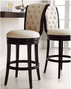 """Monohan"" Tufted Barstool & Counter Stool  Especially elegant seating for the bar—birch frame in a rich, dark finish is covered in ivory twill with a tufted back that curves ever so slightly. Barstool, 19.5""W x 24.5""D x 46.5""T. Counter stool, 19.5""W x 24.5""D x 40.5""T - $699 at Horchow"