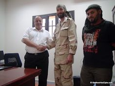 Matthew VanDyke being thanked for his service at the Ministry of Defense in Benghazi, Libya after the Libya War