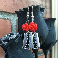 A personal favorite from my Etsy shop https://www.etsy.com/listing/478240801/razor-blade-earrings-rose-earrings-razor