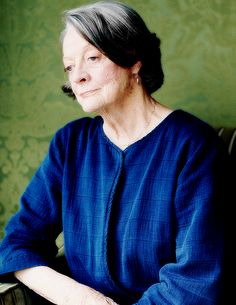 Maggie Smith, photographed by Laura Hynd for the Telegraph Magazine (2015)  She looks sharply elegant, the familiar angular features very alert, her newly coiffed hair constantly flopping over one eye like an early Hugh Grant. Her gaze is direct, her demeanour regal but not intimidating, and she is delightful: open, acerbic and receptive. ..