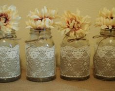 For sale is 10 beautiful handmade mason jar sleeves. Perfect for a rustic wedding! Colors of flowers are tan. White lace. If wanting ivory let me know! :) Some lace will be different as depicted in pictures. Buttons might be different, but same general brownish hue.  Please note that mason jars are not included. This is to save you on shipping charges. Fits Ball QUART SIZE REGULAR MOUTH MASON JARS. I have all different kinds of Ball brand mason jars. So if you need Ball wide mouth quart…