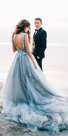 Pale, baby blue wedding dress with a long tulle train.Pale, baby blue wedding dress with a long tulle train.Home Wall Ideas Baby Blue Wedding Dresses, Baby Blue Weddings, White Bridal Dresses, Wedding Dresses With Straps, Bridal Gowns, Colored Wedding Dress, Light Blue Wedding Dress, Ombre Wedding Dress, Beach Weddings