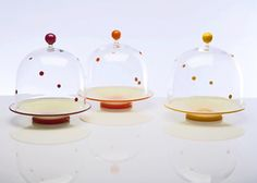 Polka Dot Covered Dishes Description: Hand blown glass Dimensions: H:11.50 x W:11.00 x D:11.00 Inches