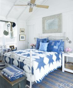 This is the master bedroom in the East Hampton home of Buffy Birrittella, a Ralph Lauren executive. It is dressed, of course, with Ralph Lauren Home linens and an antique American quilt with striking blue bursts. It is light, airy and cottage chic. Small Apartment Bedrooms, Coastal Bedrooms, Small Rooms, Coastal Living, Small Space, Blue Rooms, White Bedroom, Master Bedroom, Blue Walls