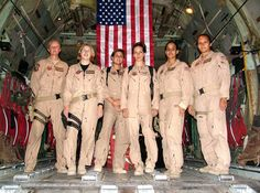 An all-female crew pauses in the cargo bay of their Lockheed C-130 Hercules for a group photo following a historic flight in 2005. It was the first time an all-female C-130 crew flew a combat mission.