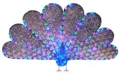 """33"""" x 60"""" Majestic Regal Peacock Lighted LED Christmas Yard Art Decoration by PENN. $148.99. From the Regal Peacock CollectionItem #54-655-066Peacock features an impressive, dazzling geometric design on its tail feathers and is accented with tons of shiny silver sequins to add extra sparkle to your decorPeacocks body is done in acrylic jewelsPre-lit with 120 multi-colored concave wide angle LED lights6 foot blue lead cordContains 1 plug with an end connector, allowing yo..."""