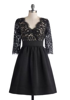Get all dressed up for a fancy date by donning this lacy black dress! Dreaming of your five-course french meal, you zip this lace-sleeved frock over emerald wedges and clasp your beloved vintage pendant above its V-shaped neckline.