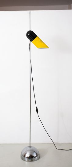 Fabio Lenci Attributed; Chromed and Enameled Metal Floor Lamp by Guzzini, 1960s.