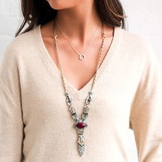 Warm golds, rich reds + sparkling crystals come together in this convertible necklace. Switch things up for a night of dancing by removing the tassel pendant, or go from long-to-short with our signature double clip closures!