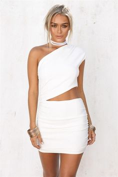 The striking Cassidy Dress is a one shoulder style and is made from a thick, off-white fabric that offers slight stretch. It is a super mini design and features a triangle cutout at waist, one shoulder sleeve and flattering gathering up sides of skirt. Complete the look with neutral heels and a choker! Exclusively designed by Sabo Skirt.