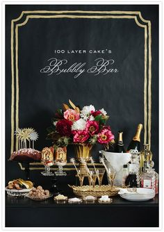 rich colors, all gold glassware and serving trays and basin and vases with black and rich colors for flowers.